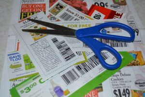 scattered coupons and pair of scissors