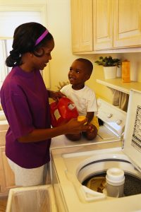 Woman putting detergent in washer